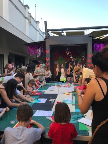 Participants enjoying Elysha Rei's Kirigami papercutting workshop
