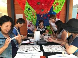 Yumiko Kigoshi teaching participants Sumi-e and Shodo (Japanese calligraphy)